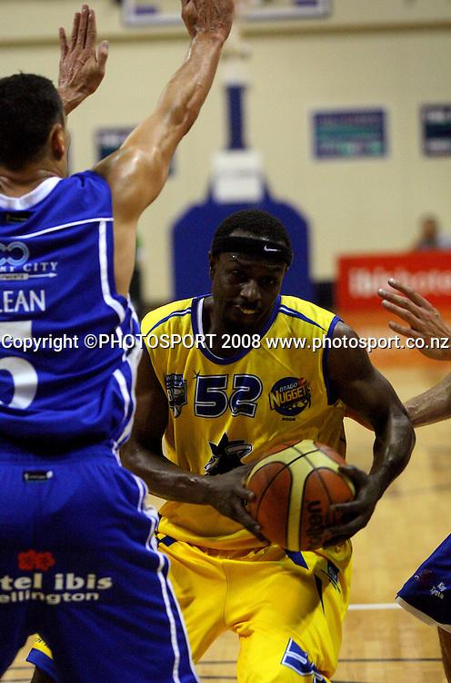 Lemar Gayle up against Troy McLean.<br /> NBL Basketball. Wellington Saints v Otago Nuggets, TSB Bank Arena, Wellington. Sunday, 30 March 2008. Photo: Dave Lintott/PHOTOSPORT