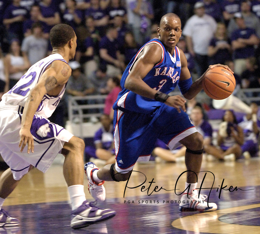 Russell Robinson (3) of Kansas brings the ball up court against pressure from Kansas State's Mario Taybron (22), during the first half at Bramlage Coliseum in Manhattan, Kansas, March 4, 2006.  The Jayhawks won 66-52.