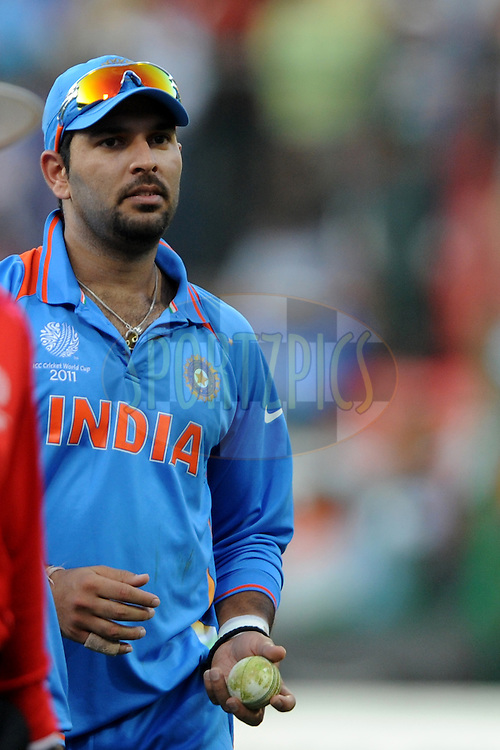 Yuvraj Singh of India walks back with the ball after taking five wickets during the ICC Cricket World Cup match between  India and Ireland held at the M Chinnaswamy Stadium in Bengaluru, Bangalore, Karnataka, India on the 6 March 2011..Photo by Pal Pillai/BCCI/SPORTZPICS
