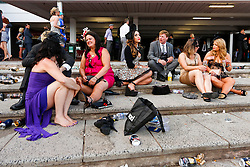 © Licensed to London News Pictures. 5/11/2013. Racegoers rest on the steps at the end of the day during Melbourne Cup Day at Flemington Racecourse on November 5, 2013 in Melbourne, Australia. Photo credit : Asanka Brendon Ratnayake/LNP