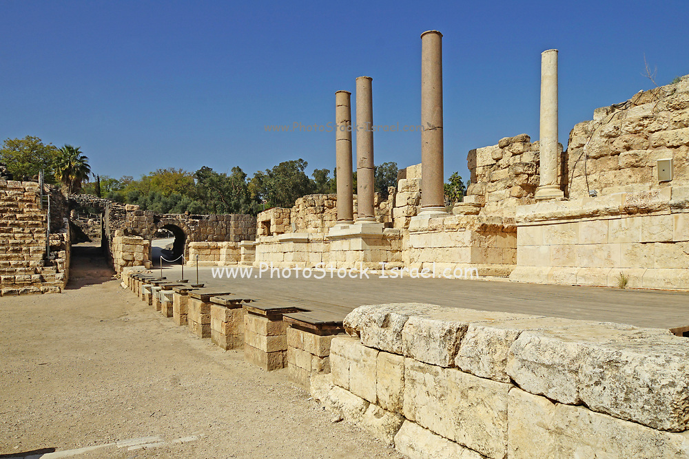 """Israel, Bet Shean Roman theatre the scaenae frons an elaborate backdrop wall behind the stage, dating from the first century CE. During the Hellenistic period Bet Shean had a Greek population and was called Scythopolis. In 64 BCE it was taken by the Romans, rebuilt, and made the capital of the Decapolis, the """"Ten Cities"""" of Samaria that were centers of Greco-Roman culture."""