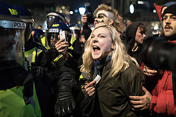 © Licensed to London News Pictures . 05/11/2016 . London , UK . Supporters of Anonymous , many wearing Guy Fawkes masks , attend the Million Mask March bonfire night demonstration , and clash with police in Trafalgar Square in central London . Photo credit : Joel Goodman/LNP