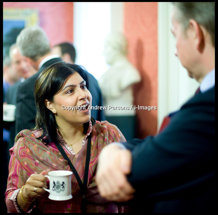 Sayeeda Warsi attends the first Cabinet meeting inside the Cabinet room, 10 Downing Street, London, UK, Thursday May 13, 2010. Photo By Andrew Parsons / i-Images