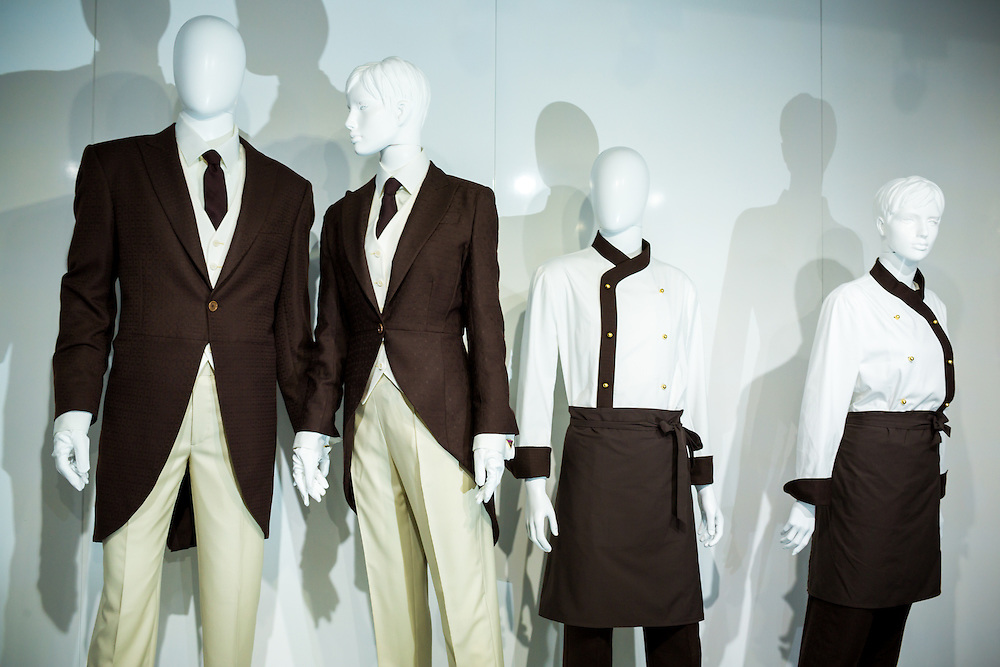 ABU DHABI, UAE - FEBRUARY 8, 2015: The new collection of Etihad Airways uniforms has been designed by Italian Haute Couturier, Ettore Bilotta.