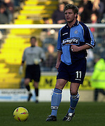Photo Peter Spurrier.22/02/2003.Sport - Nationwide Football League Div 2.Wycombe Wanders v Wigan Athletic.Dannie Bulman