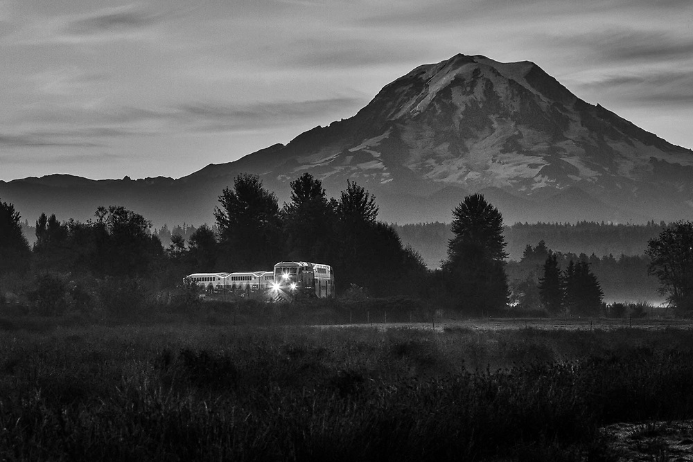 The sun is still minutes away before it rises over the Cascades as a Tacoma bound Sounder zips through the farms near Puyallup.
