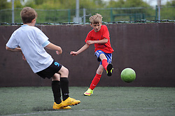 Children play football during the Bristol Sport Youth Festival - Photo mandatory by-line: Dougie Allward/JMP - Mobile: 07966 386802 - 06/06/2015 - SPORT - Multi-Sport - Bristol - SGS Wise Campus - Bristol Sport Festival Of Youth Sport - Festival Of Youth