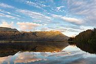 Sunset light on Robe Lake and Chugach Mountains near Valdez in Southcentral Alaska. Summer. Evening.