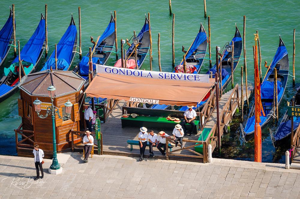 Gondolas and gondoliers in Piazza San Marco (St. Mark's Square), Venice, Veneto, Italy