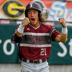 Texas Southern infielder Gaudencio Lucca (21) celebrates after scoring the go ahead run on a hit by infielder Gerreck Jimenez (11) against the Alabama State during the top of the thirteenth inning of the SWAC baseball championship final in New Orleans, La. Sunday, May 21, 2017.