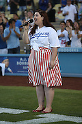 LOS ANGELES, CA - AUGUST 22:  Singer-songwriter Mary Danielle Lambert singe the National Anthem before the Los Angeles Dodgers game against the New York Mets at Dodger Stadium on Friday, August 22, 2014 in Los Angeles, California. The Dodgers won the game 6-2. (Photo by Paul Spinelli/MLB Photos via Getty Images) *** Local Caption *** Mary Lambert
