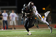 Khalil Banks (4) of The Colony is tackled by Andrew McGee-Collins (7) of Frisco Heritage during a high school football game at Tommy Briggs Cougar Stadium in The Colony, Texas on September 11, 2015. (Cooper Neill/Special Contributor)