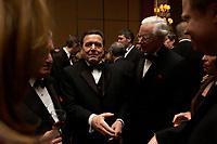 """20 NOV 2003, NEW YORK/USA:<br /> Gerhard Schroeder, SPD, Bundeskanzler, im Gespraech mit Spitzenvertretern der Wirtschaft, waehrend einem Empfang vor einer Festveranstaltung des American Institute for Contemporary German Studies anl. der Verleihung des """"Global Leadership Awards"""" Hotel Grand Hyatt at Grand Central<br /> IMAGE: 20031120-03-007<br /> KEYWORDS: Gerhard Schröder, U.S.A., Reise, Smoking<br /> Gespräch"""
