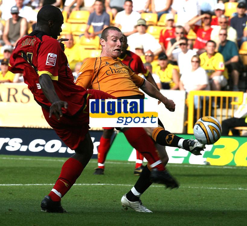 Photo: Paul Greenwood. <br />Wolverhampton Wanderers v Watford. Coca Cola Championship. 11/08/2007. <br />Watford's Danny Shittu (L) tries to block the shot of Stehen Elliott
