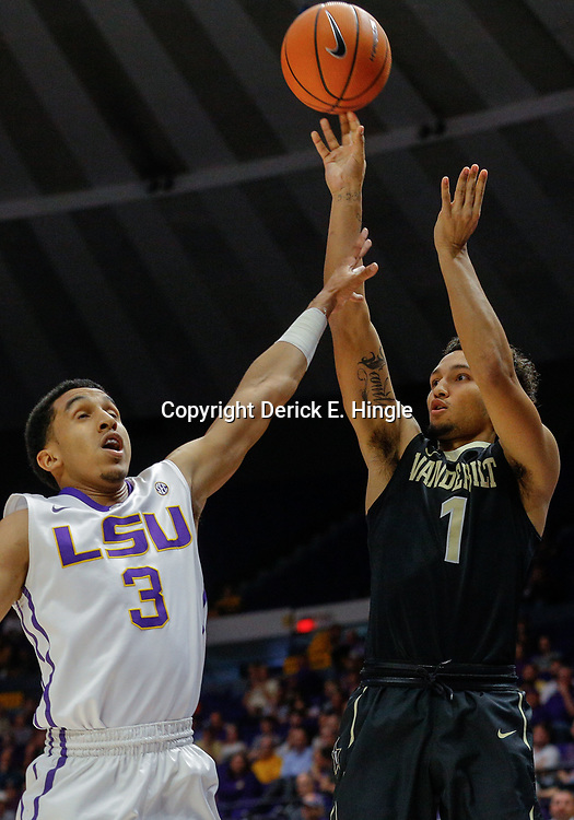 Feb 20, 2018; Baton Rouge, LA, USA; Vanderbilt Commodores guard Payton Willis (1) shoots over LSU Tigers guard Tremont Waters (3) during the first half at the Pete Maravich Assembly Center. Mandatory Credit: Derick E. Hingle-USA TODAY Sports
