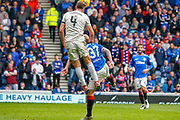 Andrew Considine of Aberdeen FC uses Scott Arfield of Rangers FC to get a little extra lift during the Ladbrokes Scottish Premiership match between Rangers and Aberdeen at Ibrox, Glasgow, Scotland on 27 April 2019.