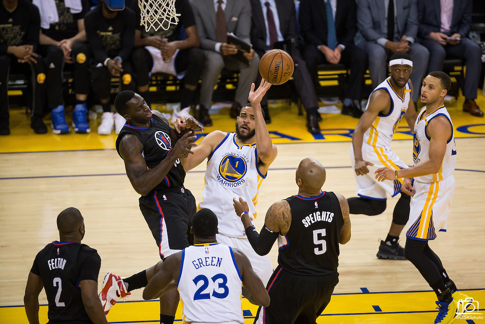 Golden State Warriors center JaVale McGee (1) tips a rebound against the LA Clippers at Oracle Arena in Oakland, Calif., on February 23, 2017. (Stan Olszewski/Special to S.F. Examiner)