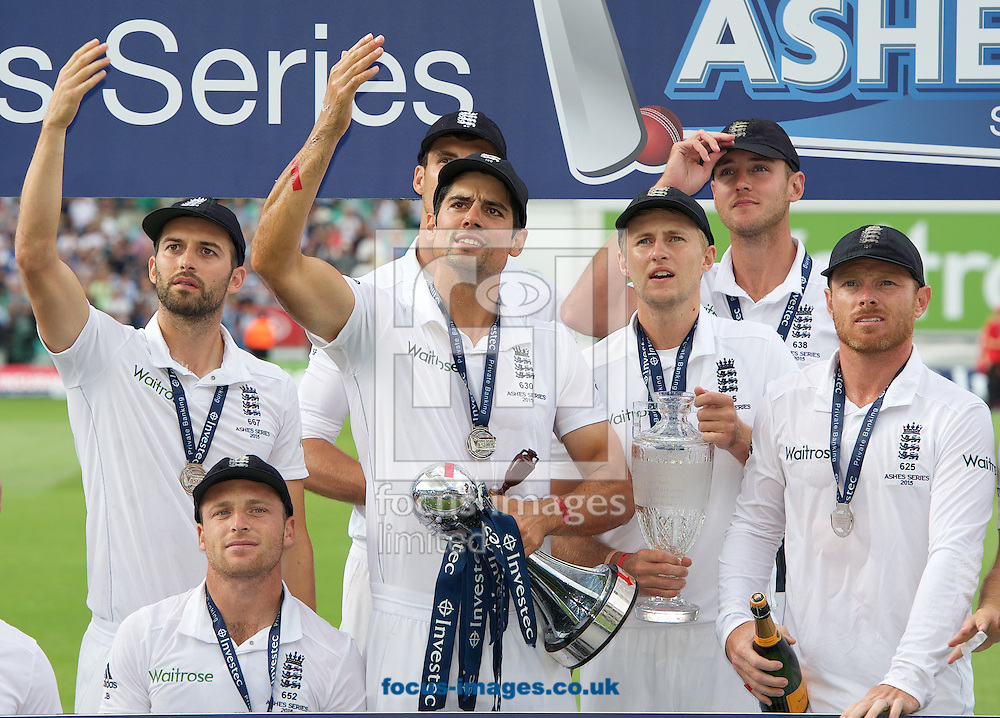 Captain Alastair Cook of England gestures to someone in the crowd after winning the series in the 5th Investec Ashes Test match at the Kia Oval, London<br /> Picture by Alan Stanford/Focus Images Ltd +44 7915 056117<br /> 23/08/2015