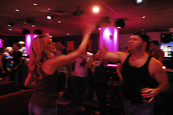 "Team from ""Grease""..---.New York, NY: Friday, Sept. 5, 2008 : Leisure Time Bowl at Port Authority in New York, NY: The broadway show bowling league - more than a hundred broadway actors, directors, and crew members get together every thursday night at leisure time bowl in the port authority from 11 p.m. until 2 a.m. ..NOTE: PLENTY of add'l images if need for slideshow..---.ROB BENNETT for The New York TImes"