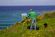 Landscape artist painting on canvas