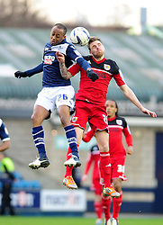 Bristol City's Paul Anderson and Millwall's Nadjim Abdou battle for the ball in the air - Photo mandatory by-line: Dougie Allward/JMP - Tel: Mobile: 07966 386802 01/01/2013 - SPORT - FOOTBALL - The Den - London -  Millwall v Bristol City - Championship.