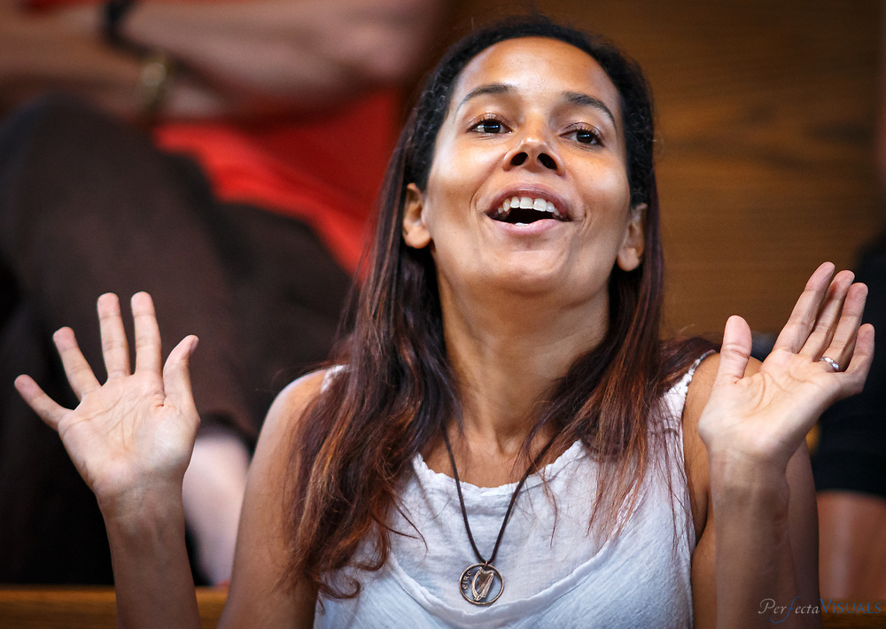 "American musician Rhiannon Giddens answers questions after singing ""Cry No More,"" at a music workshop at  the Augusta Heritage Center of Davis & Elkins College in Elkins, West Virginia, Wednesday, August 5, 2015. The blues/gospel performance is a response to the tragedy and racially-motivated crimes committed last month inside the Emanuel African Methodist Episcopal (AME) Church in Charleston, S.C. Giddens was a founding member of the Grammy-winning band Carolina Chocolate Drops before embarking on a successful solo career."