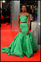 Lupita Nyong'o arrives for the EE BRITISH ACADEMY FILM AWARDS 2014 (BAFTA) at the The Royal Opera House in Covent Garden . London, United Kingdom. Sunday, 16th February 2014. Picture by Andrew Parsons / i-Images<br /> Kenyan Oscar-winning actress Lupita Nyong'o, 31, has been named the world's most beautiful person for 2014 by People magazine. Photo filed Thursday 24th April 2014.