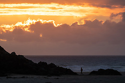 © Licensed to London News Pictures. 01/07/2020. Perranporth, UK. The sun sets on Perranporth beach. From this weekend, a large number of tourists are expected to arrive in Cornwall, as the regulations on COVID-19 (Coronavirus) are lifted. Photo credit : Tom Nicholson/LNP
