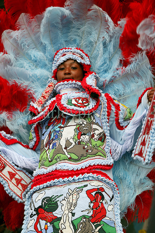 27 April 2012. New Orleans, Louisiana,  USA. .New Orleans Jazz and Heritage Festival. .Members of the Comanche Hunters Mardi Gras Indians on the Jazz and Heritage Stage..Photo; Charlie Varley.