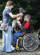 Elena Shamkovich, left, helps her son Evan Sugrue, 11, with his helmet before Evan played a paintball game at the Montgomery Sporting Goods paintball fields in the Town of Wallkill on Saturday, Sept. 21, 2013. Ben Chesser, who also played, is in the background.
