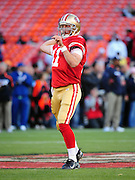 November 12, 2009; San Francisco, CA, USA; San Francisco 49ers quarterback Alex Smith (11) warms up before the game against the Chicago Bears at Candlestick Park. The 49ers defeated the Bears 10-6. Mandatory Credit: Kyle Terada-Terada Photo