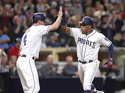May 2, 2017 - San Diego, CA, USA - The San Diego Padres' Yangervis Solarte, right, high-fives Wil Myers after Myers scored on Solarte's two-run home run in the sixth inning against the Colorado Rockies at Petco Park in San Diego on Tuesday, May 2, 2017. (Credit Image: © Hayne Palmour Iv/TNS via ZUMA Wire)