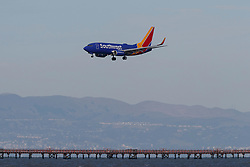 Boeing 737-7H4 (N454WN) operated by Southwest Airlines on approach to San Francisco International Airport (KSFO), San Francisco, California, United States of America