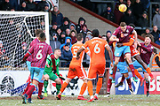 Shrewsbury Town defender Aristote Nsiala (22) and Scunthorpe United defender Murray Wallace (5) battles for the ball with their heads  during the EFL Sky Bet League 1 match between Scunthorpe United and Shrewsbury Town at Glanford Park, Scunthorpe, England on 17 March 2018. Picture by Mick Atkins.