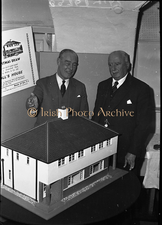 Presentation of Doll House to the I.S.P.C.C.<br /> 1961.<br /> 14.11.1961.<br /> 11.14.1961.<br /> 14th November 1961.<br /> A doll's house built by Wates was donated to the I.S.P.C.C. as the main prize in their annual raffle. The house is a scale model of houses being built by Wates &amp; Co Ltd in Greenfield Park in Santry, Dublin.<br /> Image shows the model house kindly donated by Wates &amp; Co Ltd.