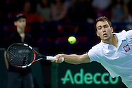 Jerzy Janowicz of Poland competes at men's single game during the BNP Paribas Davis Cup 2014 between Poland and Croatia at Torwar Hall in Warsaw on April 6, 2014.<br /> <br /> Poland, Warsaw, April 6, 2014<br /> <br /> Picture also available in RAW (NEF) or TIFF format on special request.<br /> <br /> For editorial use only. Any commercial or promotional use requires permission.<br /> <br /> Mandatory credit:<br /> Photo by © Adam Nurkiewicz / Mediasport