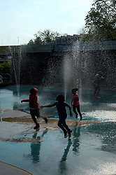 Children play at a sprayground as severe weather builds up, in Philadelphia, PA, on Primary Election Day, May 15, 2018.