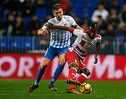 MALAGA, SPAIN - DECEMBER 09:  Uche Henry Agbo of Granada CF (R) being followed by Ignacio Camacho of Real Madrid CF (L) during La Liga match between Malaga CF and Granada CF at La Rosaleda Stadium December 9, 2016 in Malaga, Spain.  (Photo by Aitor Alcalde Colomer/Getty Images)