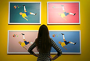 "UNITED KINGDOM, London: 22 September 2015 A member of public stands in front of ""Hermes XXI"" by artist Pedro Paricio in the Halcyon Gallery, New Bond Street, at the launch of the ""Art, Life, Football"" exhibition - in celebration of Pele's 75th birthday and a lifetime of sporting and humanitarian achievements. The exhibition opens on October 18th and includes photography, paintings and sculptures by the likes of Andy Warhol and Ronnie Wood. <br /> Credit: Story Picture Agency"