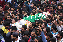 August 12, 2017 - Jammu and Kashmir, India - Thousands of people offering funeral possession of a top militant Yasin Itoo who got killed in an encounter with Government security forces at Awneera Shopian with his two other associates on 13th of August. (Credit Image: © Muzamil Bhat/Pacific Press via ZUMA Wire)