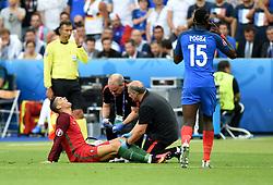Cristiano Ronaldo of Portugal, injured, received treatment  - Mandatory by-line: Joe Meredith/JMP - 10/07/2016 - FOOTBALL - Stade de France - Saint-Denis, France - Portugal v France - UEFA European Championship Final