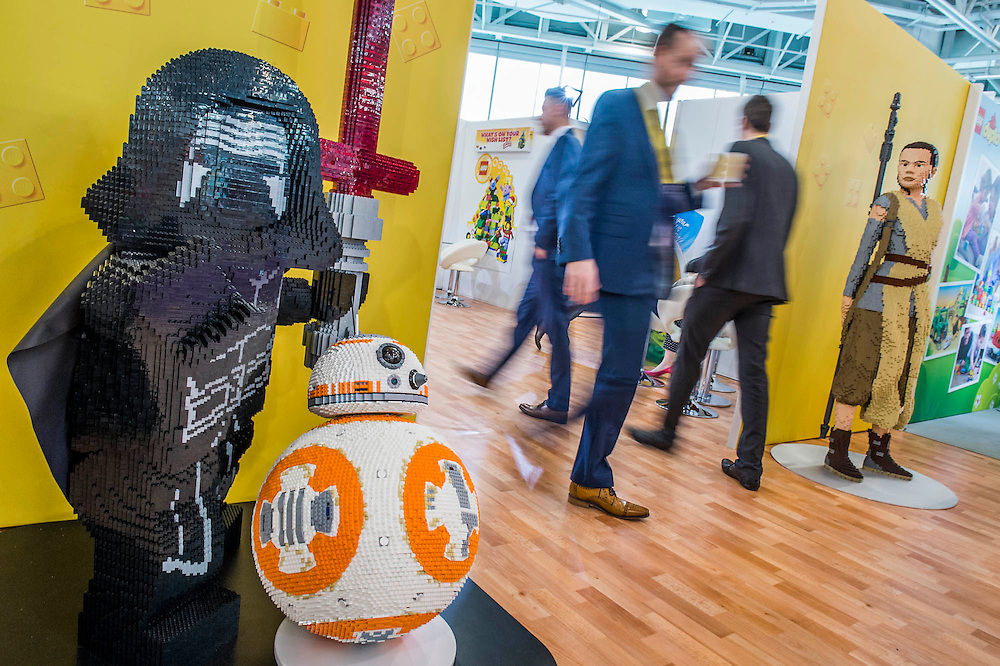 Kylo Ren,  BB-8 and Rey, Star Wars characters guard the entranc to the Lego Stand - The annual London Toy Fair, the trade show for the toy and games industry, takes place at Olympia.