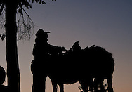 A farmer dismounts a donkey before the dusk in La Barca, Guerrero on April 17th, 2010.  (Photo: Prometeo Lucero)