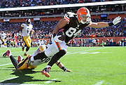CLEVELAND, OH - OCTOBER 12:  Jordan Cameron #84 of the Cleveland Browns gets tripped up by Brett Keisel #99 of the Pittsburgh Steelers during the second quarter at FirstEnergy Stadium on October 12, 2014 in Cleveland, Ohio.  (Photo by Jason Miller/Getty Images) *** Local Caption ***