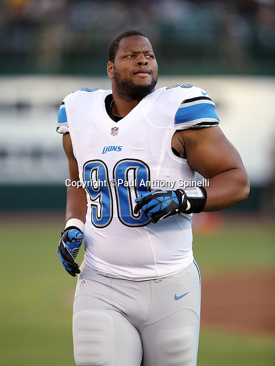 Detroit Lions defensive tackle Ndamukong Suh (90) looks on during the 2014 NFL preseason football game against the Oakland Raiders on Friday, Aug. 15, 2014 in Oakland, Calif. The Raiders won the game 27-26. ©Paul Anthony Spinelli