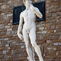 Michelangelo's David (David and Goliath) - the symbol for perfect beauty and health of the human body - in front of Palazzo Vecchio palace on Piazza della Signoria square in the city centre of Florence.