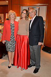 LOUISE ROE with her parents STEPHEN ROE and CHRISTINE ROE at a party to celebrate the publication of Front Roe by Louise Roe held at Ralph Lauren, 1 New Bond Street, London on 1st April 2015.