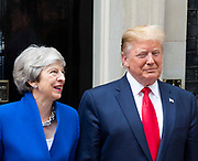 Donald Trump, US President and First Lady Melania Trump arrive in Downing Street as part of their State visit. Theresa May, Prime Minister and Mr May greet them on the doorstep of No.10 Downing Street, London, Great Britain <br /> 4th June 2019 <br /> L to R: <br /> <br /> Theresa May <br /> Donald Trump<br /> <br /> <br /> <br /> Photograph by Elliott Franks