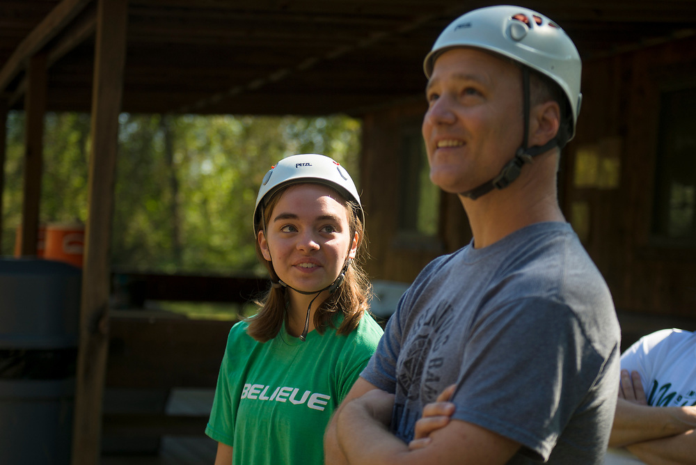 Lexi and Steve Mace watch people zipline on Sept. 30, 2018 at the Challenge Course at The Ridges. Photo by Hannah Ruhoff