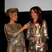 NLD/Amsterdam/20100210 - Uitreiking Jackie's Best Dressed Award 2010, Nikkie Plessen  en winnaar Leontien Borsato